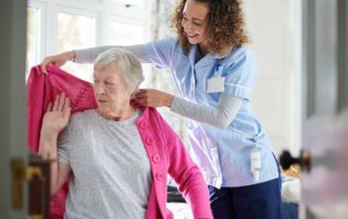 Home Care assisting with dressing